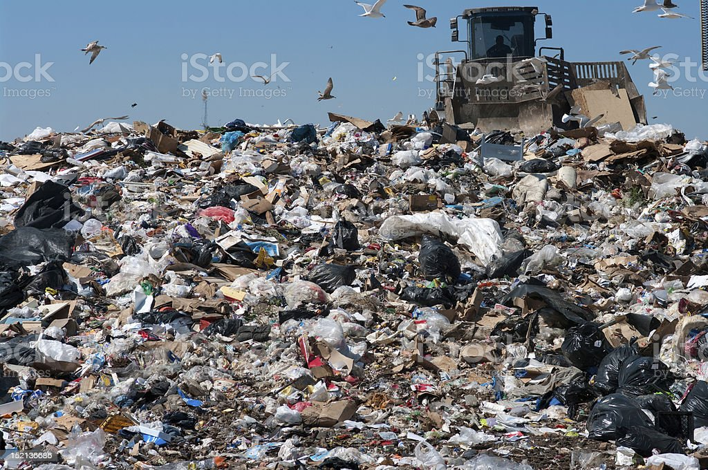 Compactor in landfill royalty-free stock photo