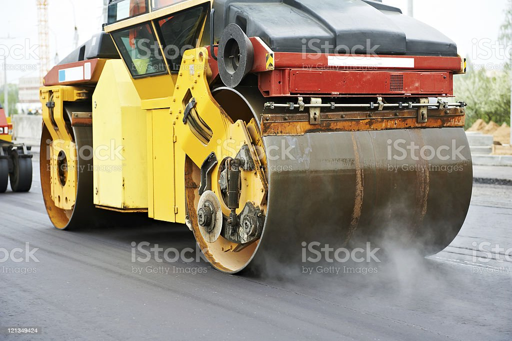 compactor roller at asphalting work royalty-free stock photo