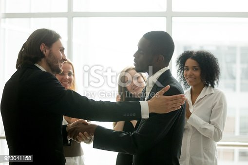 istock Company boss promoting african american employee with handshake showing gratitude 923041158
