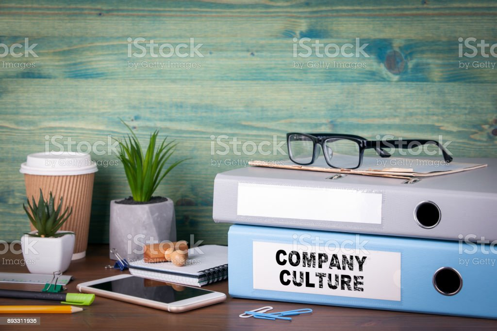 Company Culture. Binders on desk in the office. Business background stock photo