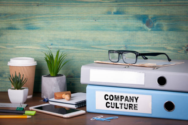 company culture. binders on desk in the office. business background - cultures stock pictures, royalty-free photos & images