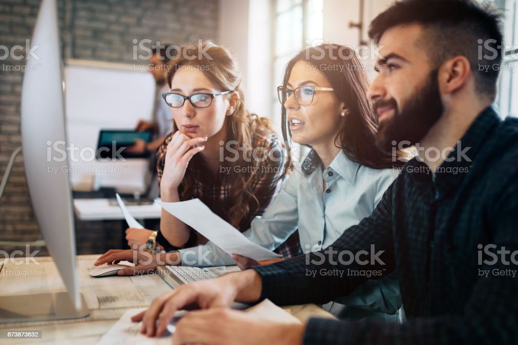 Company employees working in software development and designer office stock photo