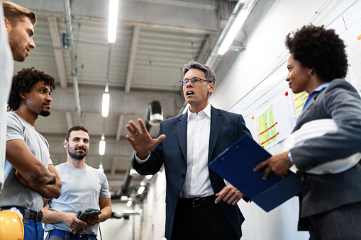 Company Leader Talking To The Employees While Visiting A Factory Stock Photo - Download Image Now