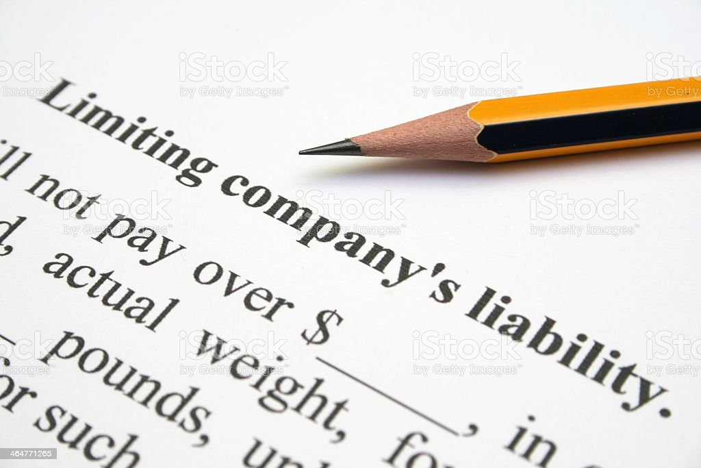 Company liability form with pencil stock photo
