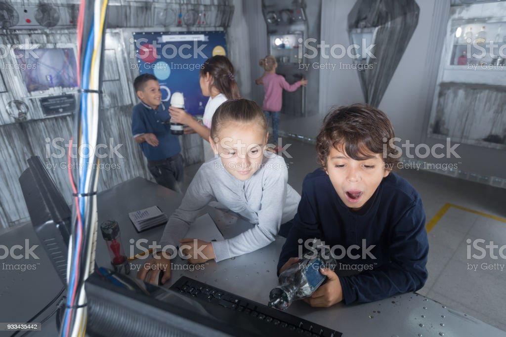 company of children in quest room bunker stock photo
