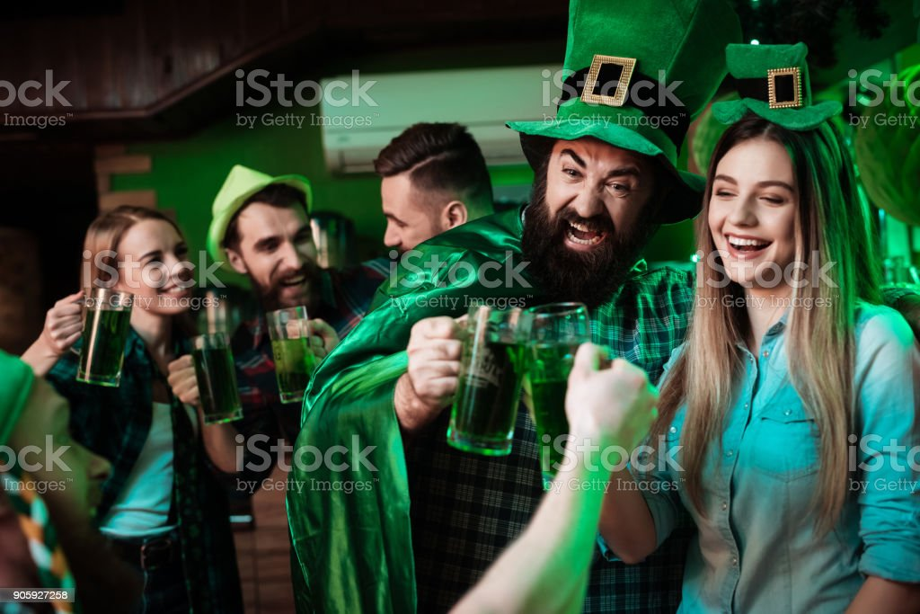 A company of young people is resting in a beer bar. stock photo