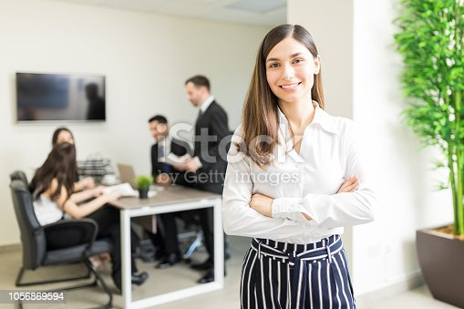 istock Company Owner Smiling In Office 1056869594