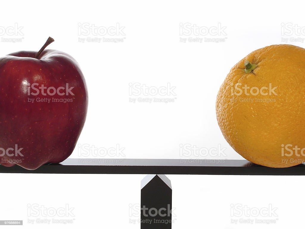 Compare Apples to Oranges Balance stock photo