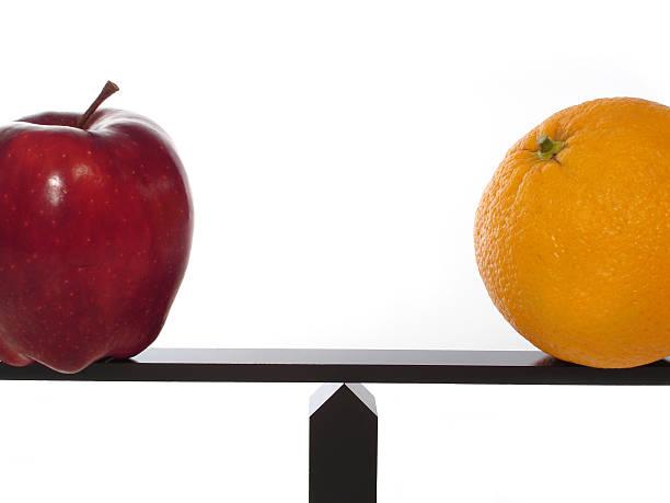 Compare Apples to Oranges Balance stock photo
