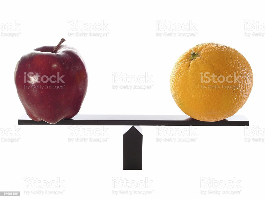 Compare Apples to Oranges Balanced royalty-free stock photo