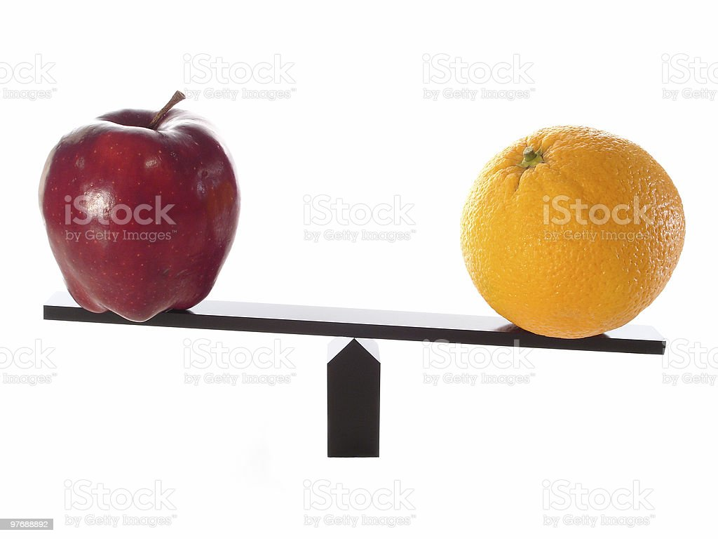 Compare Apples to Oranges Heavy stock photo