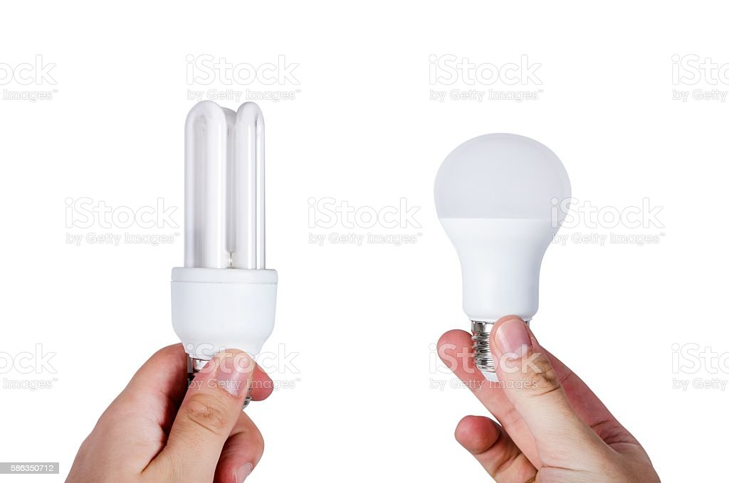 Compare two different types of bulbs. Energy saving concept stock photo