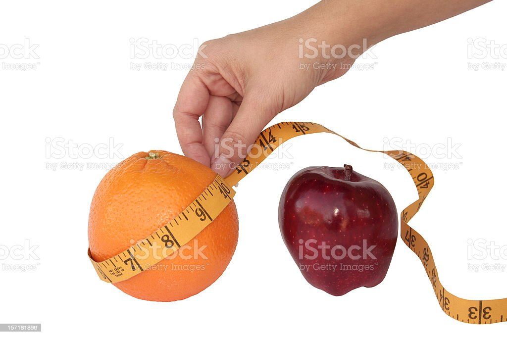 Comparing Apples to Oranges or Weight Loss royalty-free stock photo