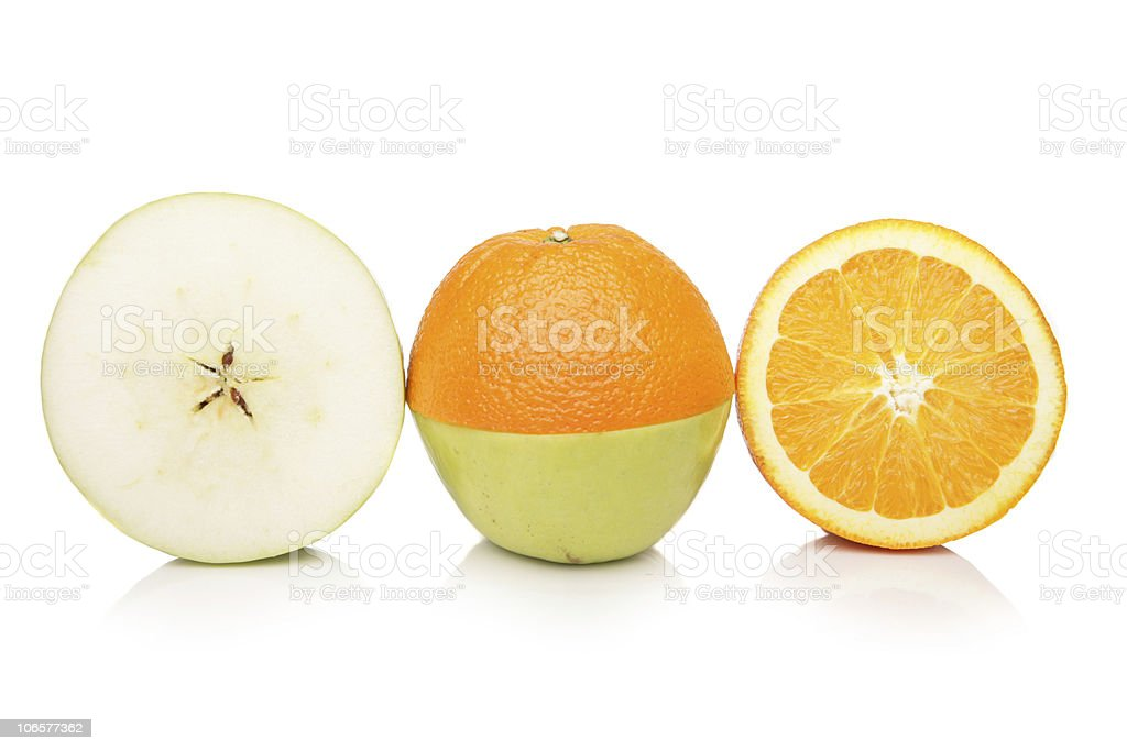 Comparing apples to oranges royalty-free stock photo