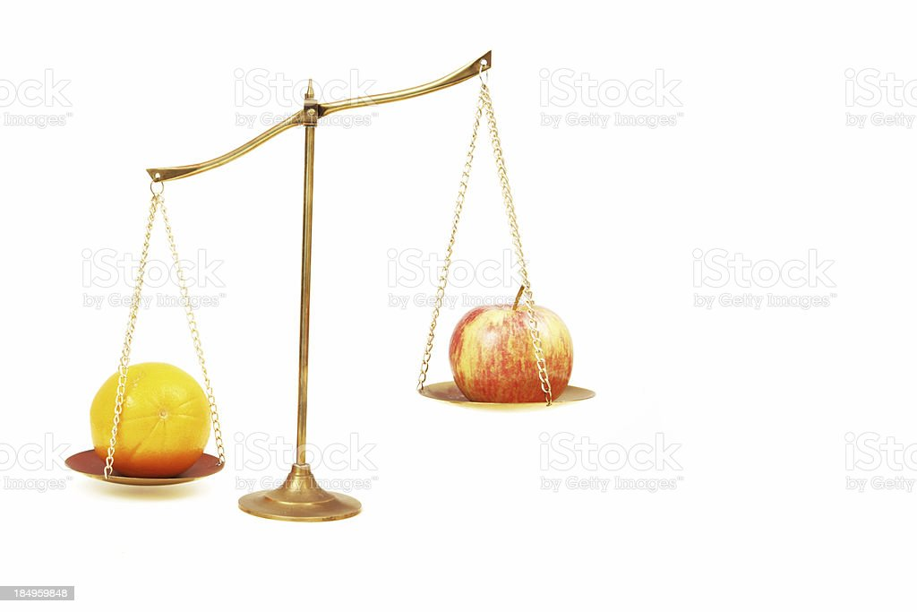 Comparing Apples to Oranges stock photo