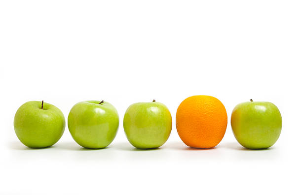 Comparing apples to oranges stock photo