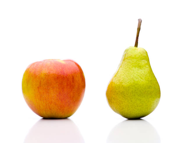 Comparing apples to oranges - the juxtaposition stock photo