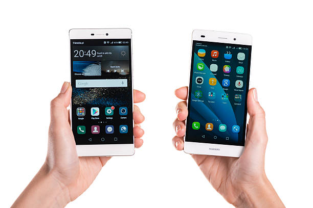 Comparing Huawei P8 and P8 Lite Koszalin, Poland - July 24, 2015: Close-up shot of white Huawei P8 and P8 Lite hand-held by woman. Devices displaying the applications on the home screen. P8 series is successor of well known P7 series. Huawei, originated in China. Now is a leading global ICT solutions provider. huawei stock pictures, royalty-free photos & images