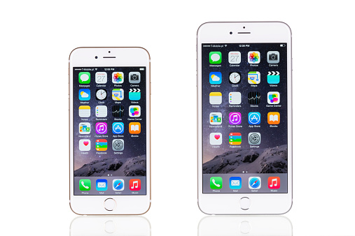 istock Comparing iPhone 6 and iPhone 6 Plus isolated on white 520438165