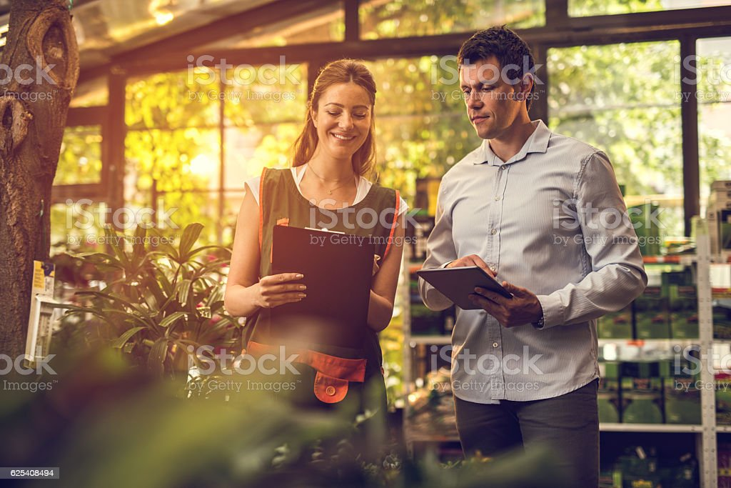 Comparing the data in garden center! stock photo
