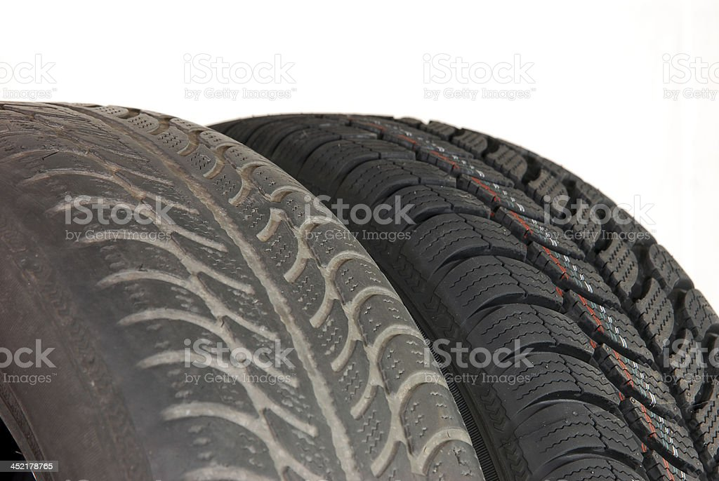 Comparing the difference between old and new winter tires stock photo