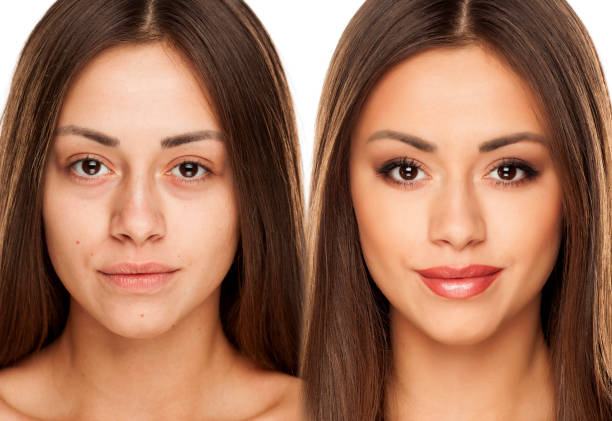 Comparision portrait of young woman without, and with makeup on a white background stock photo