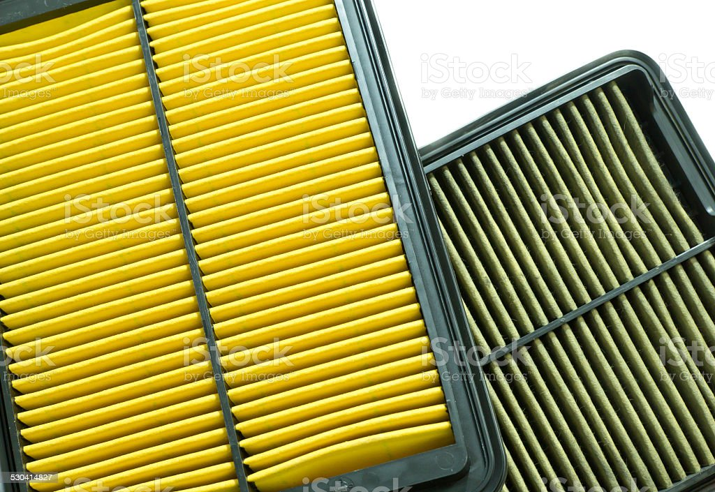 comparison between new and used air filter for car stock photo