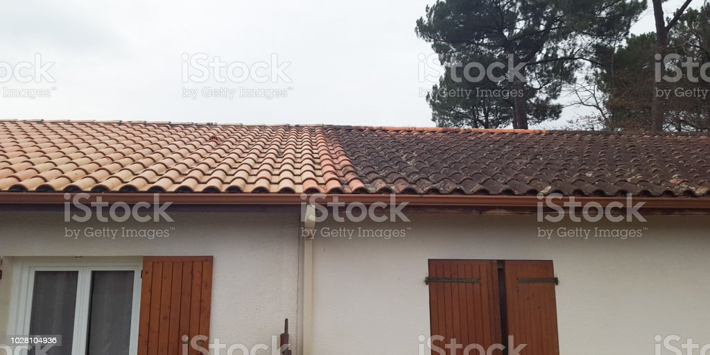 Comparison of before and after clean roof house stock photo