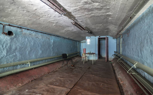 Compartment of an old abandoned buildings for civil protection Compartment of an old abandoned buildings for civil protection bomb shelter stock pictures, royalty-free photos & images