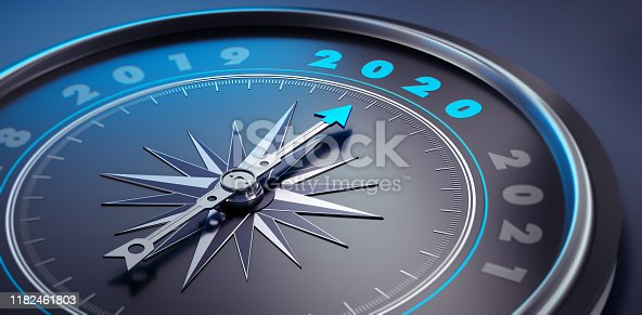 Dark stylish compass with needle pointing to the year 2020