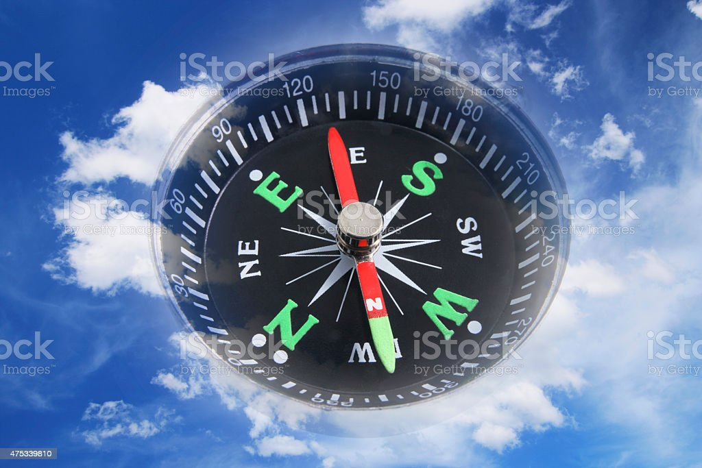 Compass and Clouds stock photo
