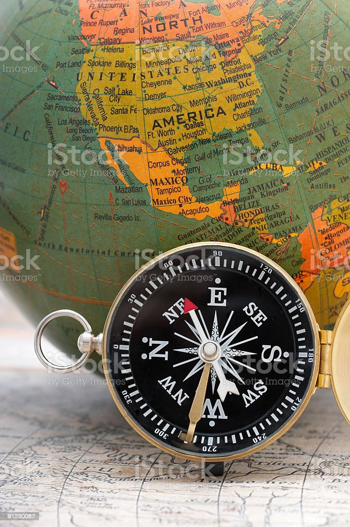 Compass and globe royalty-free stock photo