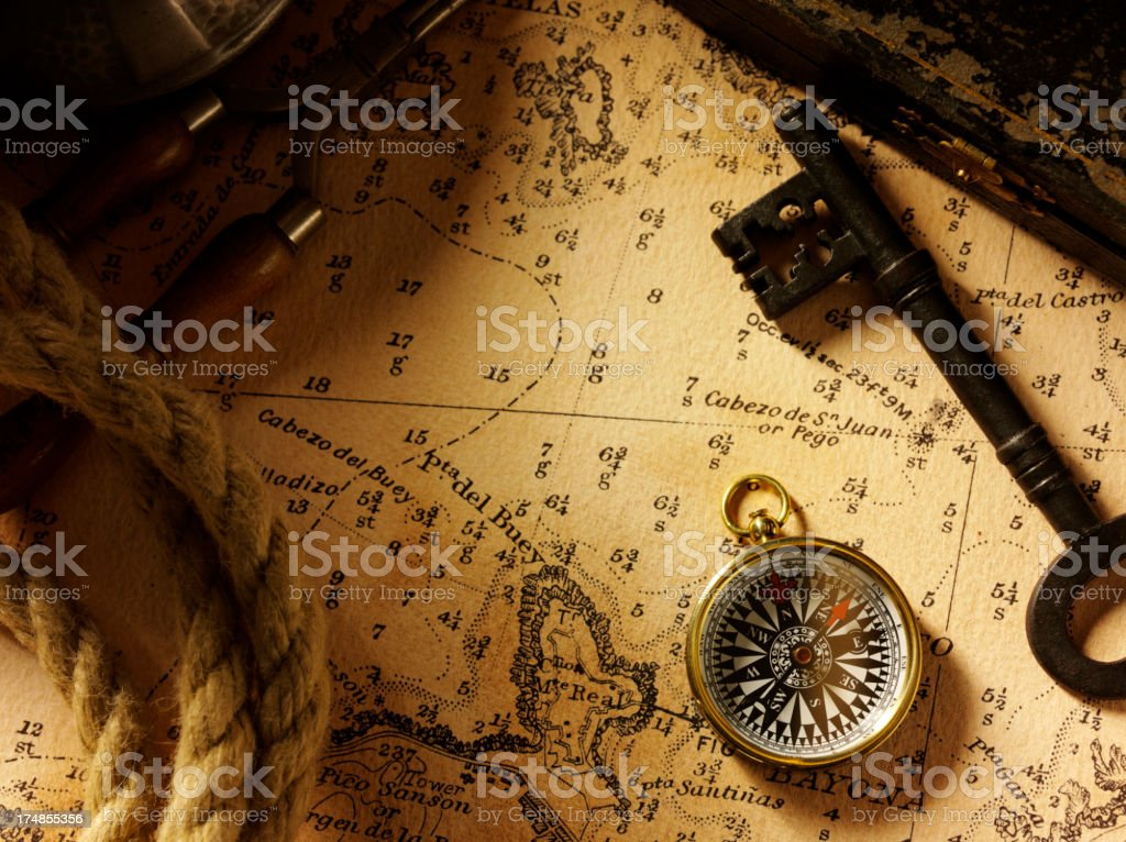 Compass and Key on a Old treasure Map stock photo