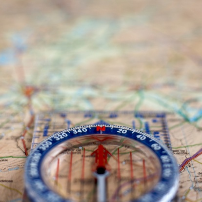 97623256 istock photo Compass and map 106439646