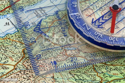 97623256istockphoto Compass and map 1086915038