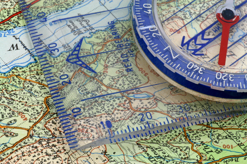 97623256 istock photo Compass and map 1086915038