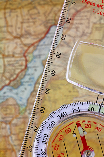 97623256 istock photo Compass and Map 1096101028