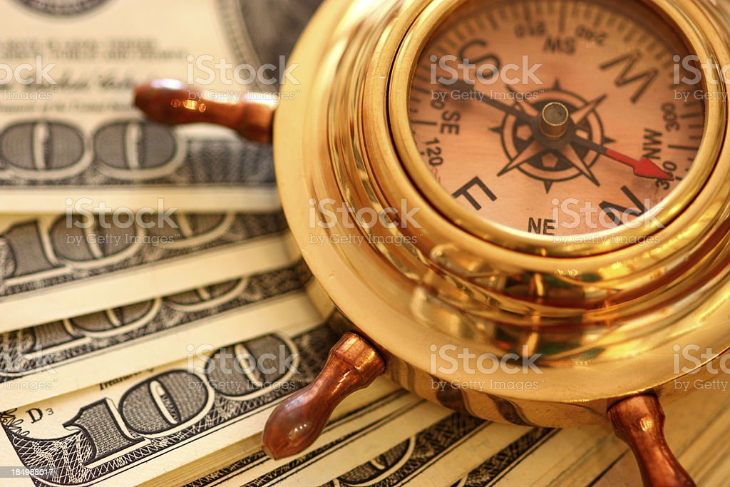 Compass and money royalty-free stock photo