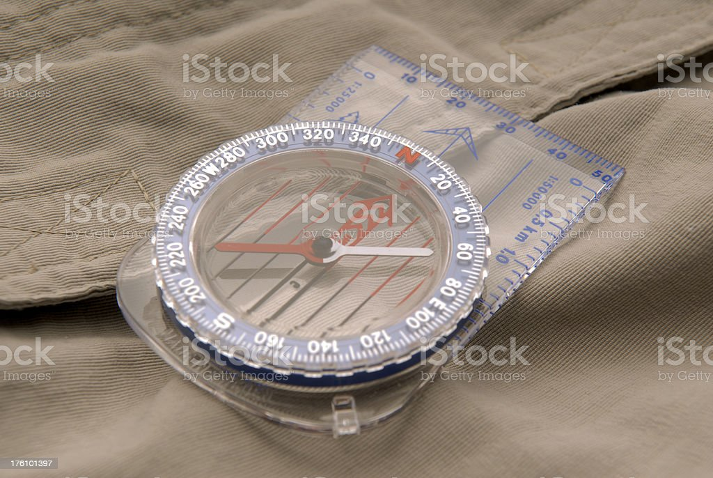 Compass and outdoor clothing royalty-free stock photo