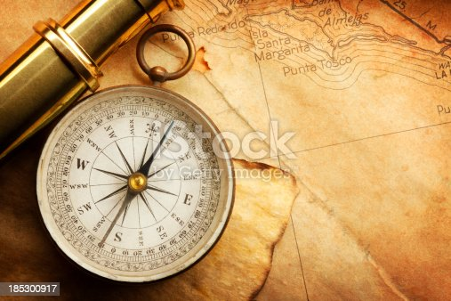 istock Compass And Spyglass On A Map 185300917