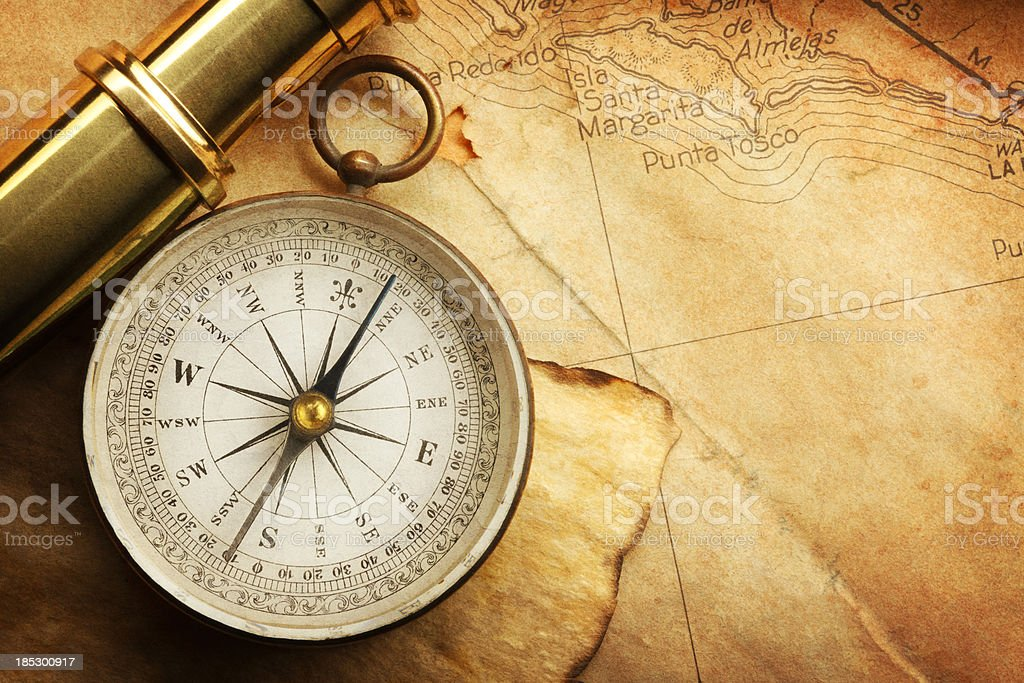 Compass And Spyglass On A Map stock photo