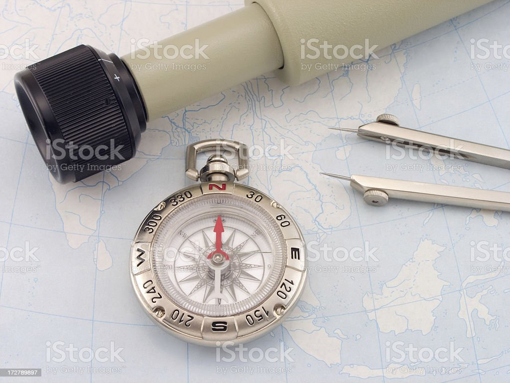 compass and spyglass stock photo