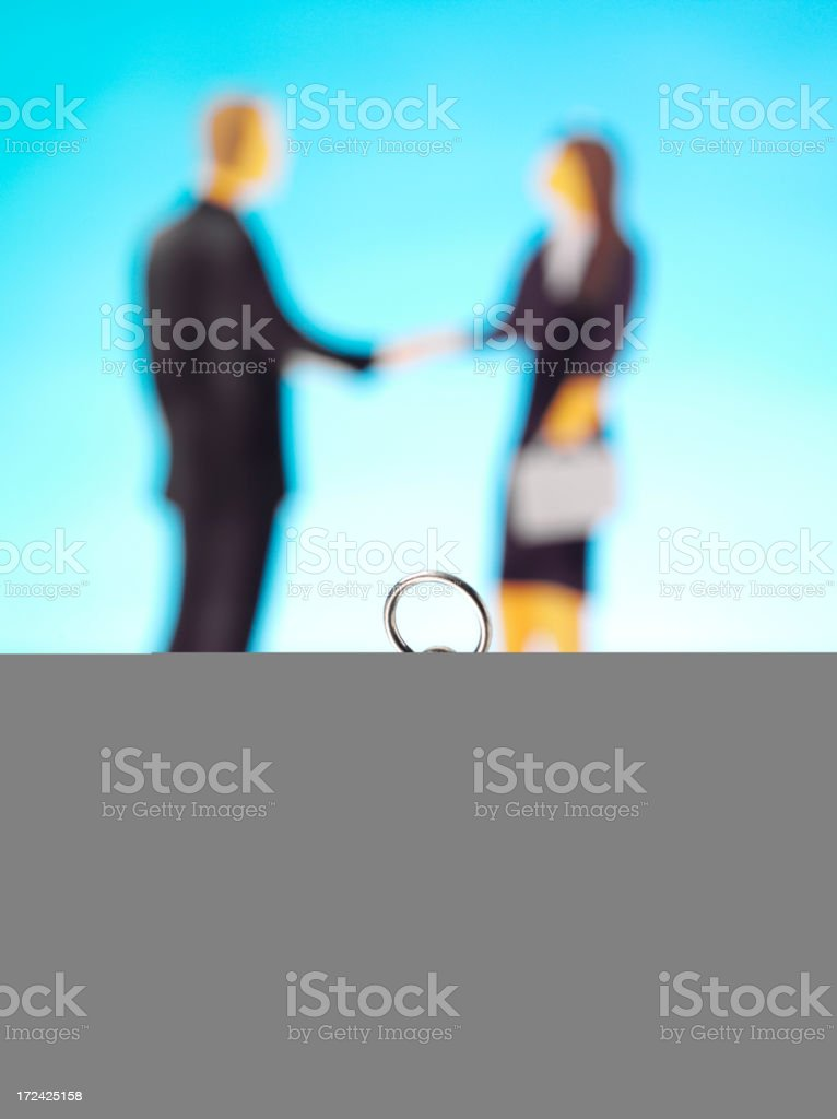 Compass and Stationery with Business People Shaking Hand royalty-free stock photo