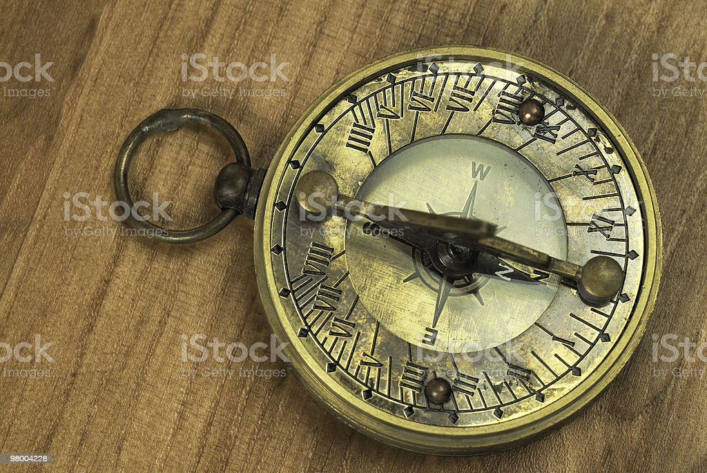 Compass and sundial on wood - Directions, orientation, geography royalty free stockfoto