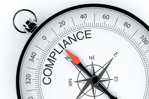 istock Compass Arrow Pointing to Compliance 1140842430