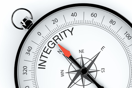 Compass Arrow Pointing To Integrity Stock Photo - Download Image Now