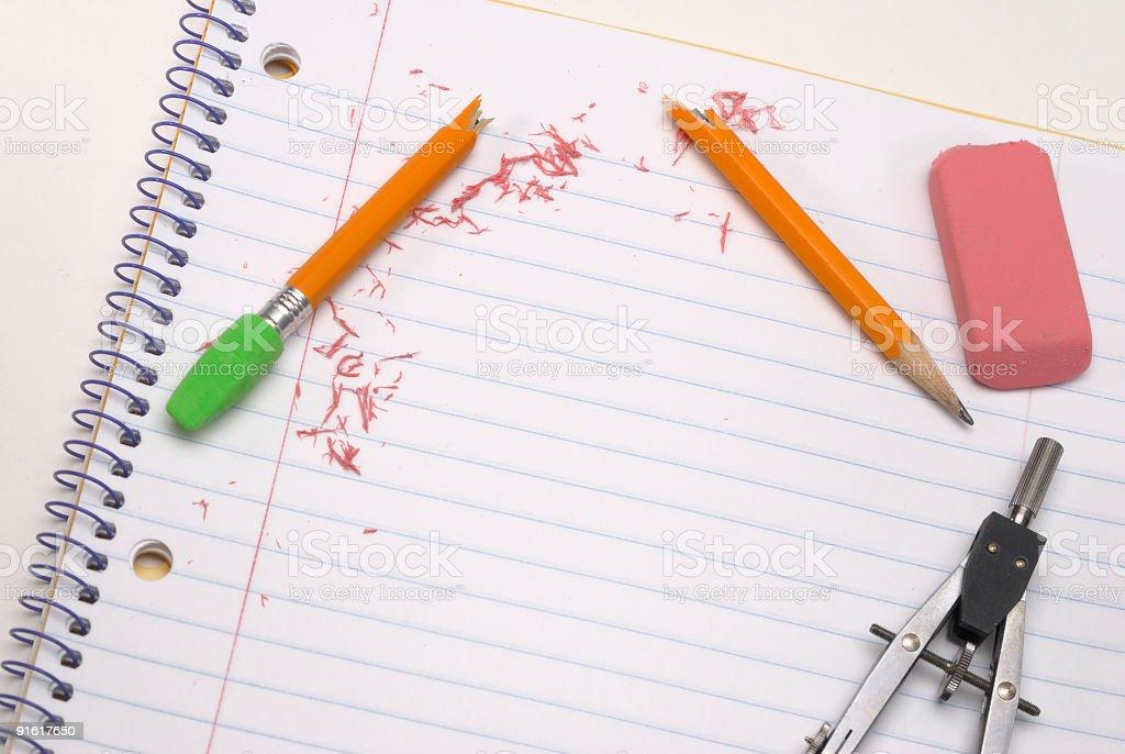 Compass, broken pencil and eraser stock photo