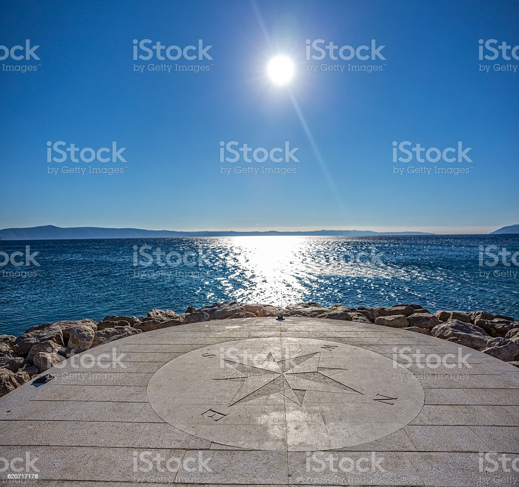 Compass by the sea stock photo
