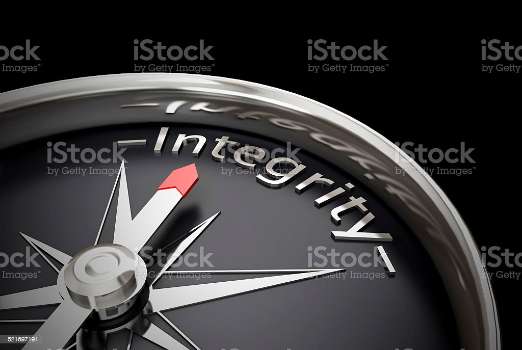 Compass direction pointing towards Integrity stock photo