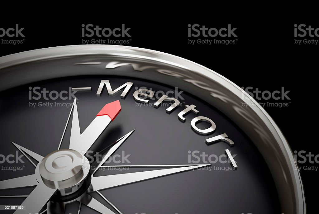 Compass direction pointing towards mentor stock photo